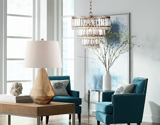 A chandelier and table lamp in a chic room.