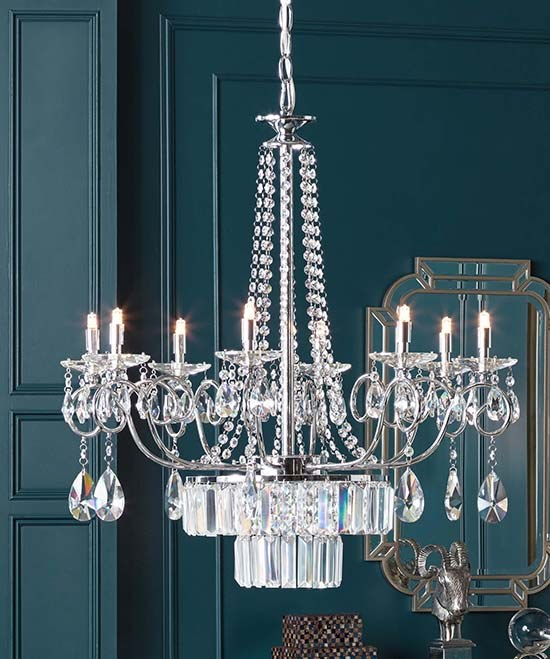 A Crystal Chandelier Hangs In Teal Room