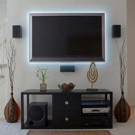 A TV featuring backlighting with tape lighting from Lamps Plus.