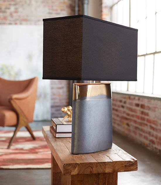 The Moonrise Noir table lamp sits within a modern room.