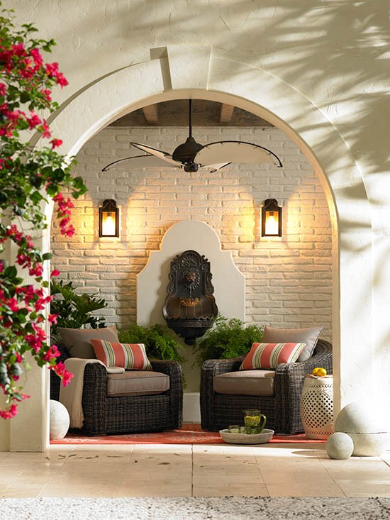 Outdoor lighting blends in with furniture pieces and a ceiling fan.