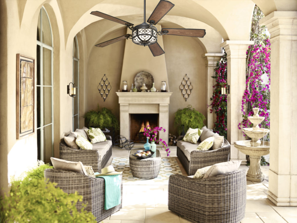 An Outdoor Ceiling Fan In A Covered Area With Furniture And Fountain