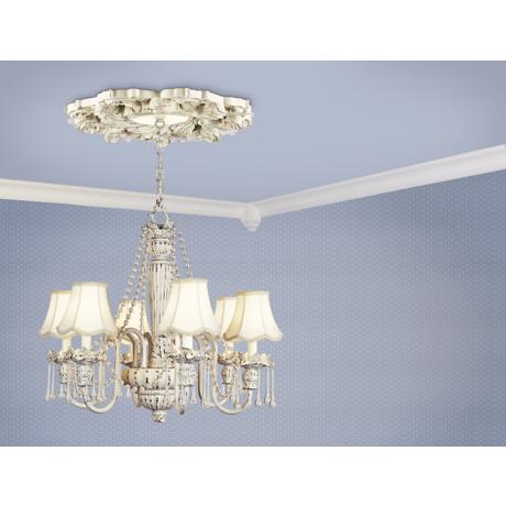 An off-white chandelier with a ceiling medallion.