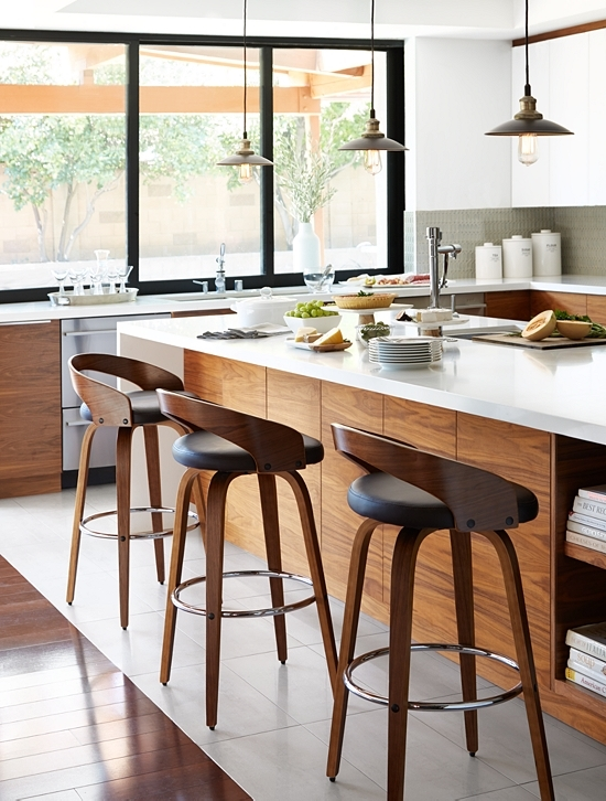 Bon Stools Are Lined Up Against A Kitchen Island.