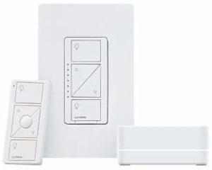 A picture of a white wireless dimmer set with dimmer, remote control, and Smart Bridge