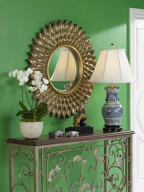 A round mirror with other decor.