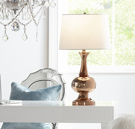 A table lamp with a golden finish base.