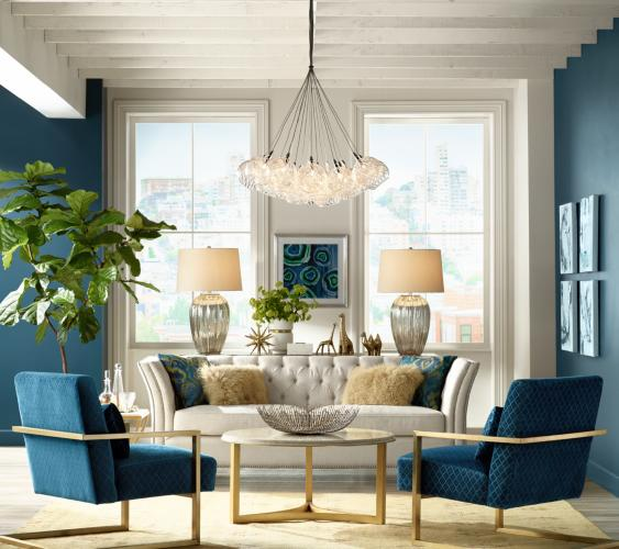 A Living Room Scene With Pair Of Table Lamps