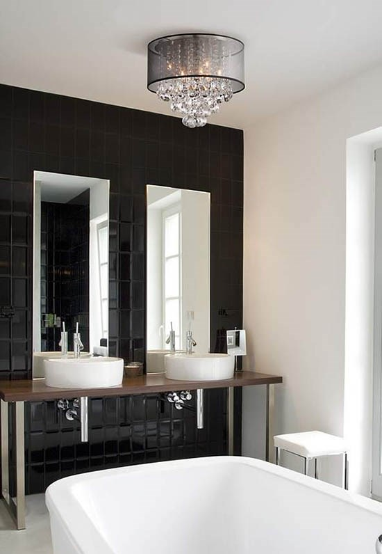 A ceiling light with crystal accents and a drum shade in a bathroom.