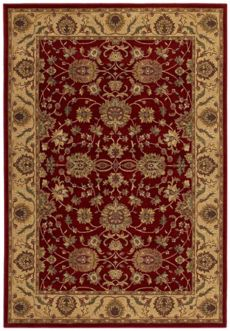 A deep red rug with golden decorative elements.