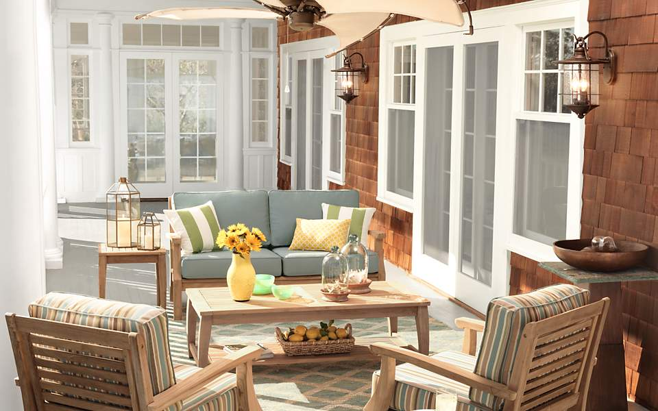 An outdoor porch setting with outdoor furniture.