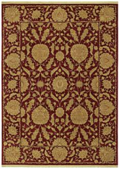 A dark red rug with golden brown decorative elements.