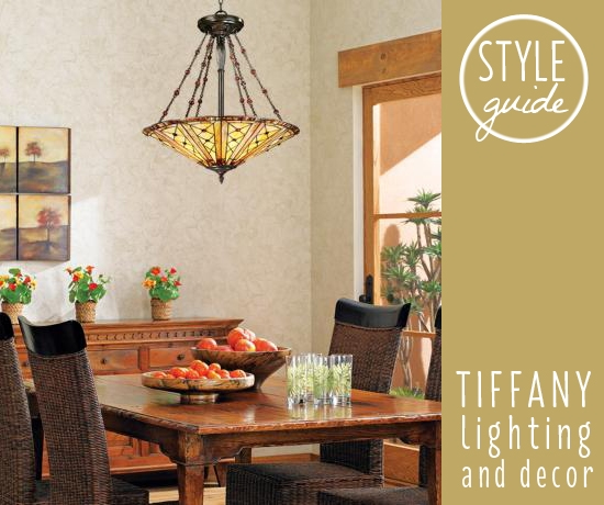 A Tiffany style chandelier hangs above a dining room table.