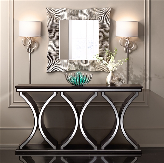 Two sconces and a square mirror in modern decor.