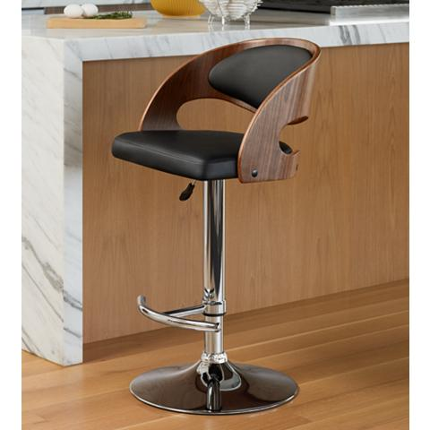 Handsome black leather and walnut finish barstool.