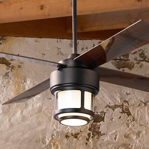 Modern-industrial ceiling fan with a light kit and four dark wood blades.