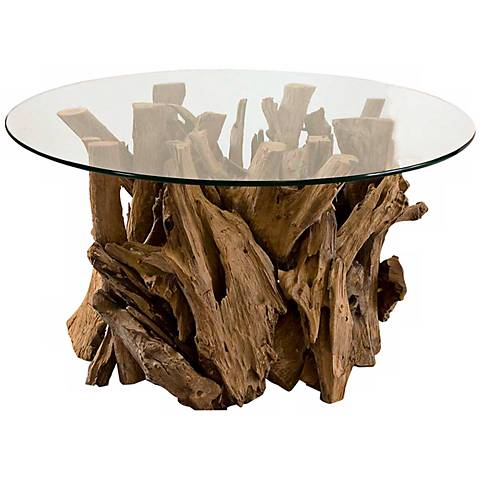 A Lamps Plus coffee table featuring a driftwood base and a glass table surface.