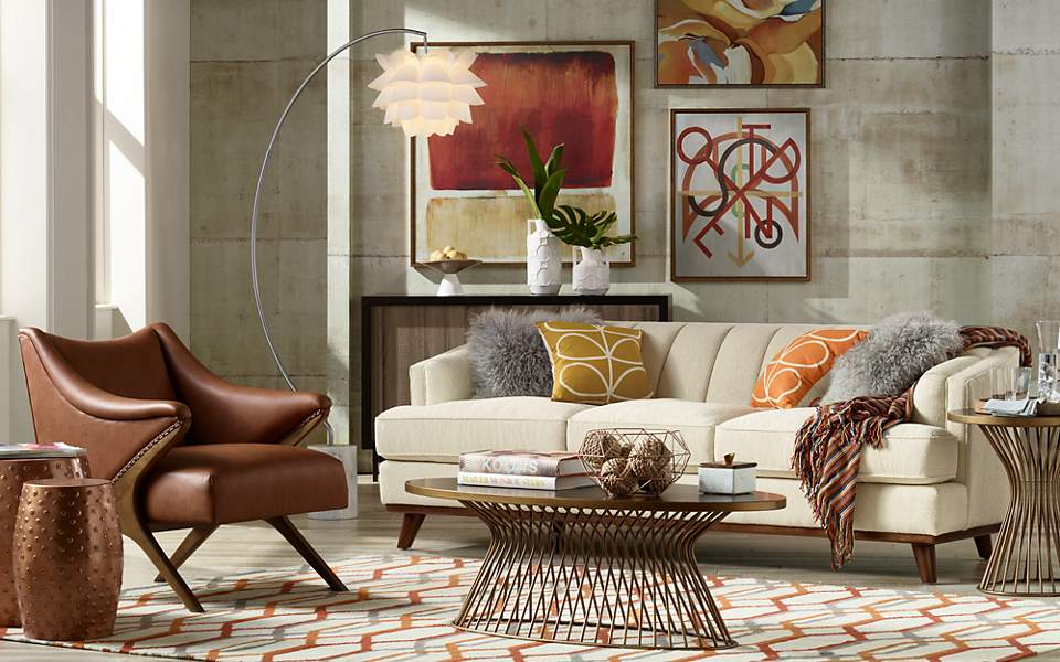 A living room featuring warm fall colors and textures.