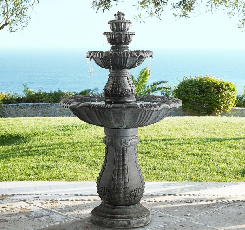 Tiered fountain in a back yard with an ocean view