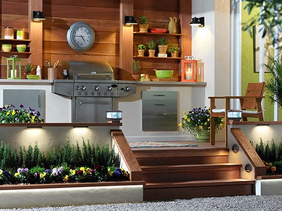 An outdoor grill area with outdoor lighting.