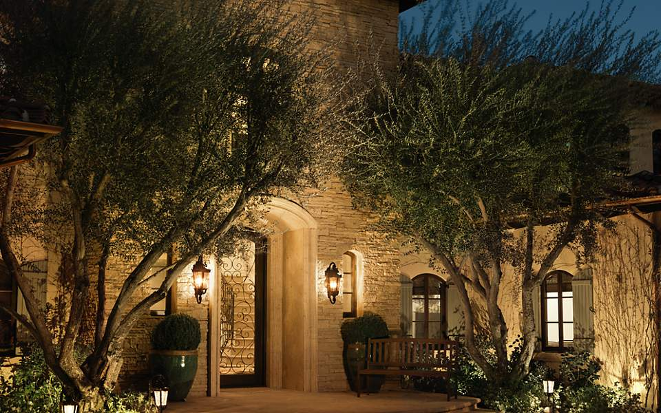 Spanish Colonial House That Glows Brightly At Night Due To The Lighting With Two Outdoor