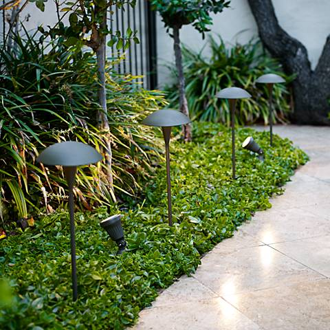 Four dark bronze mushroom-shaped path lights.