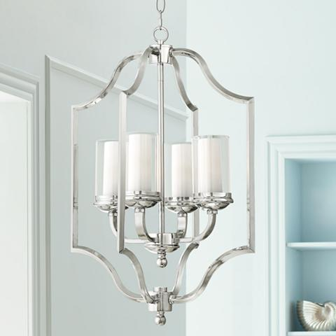 Beautiful silver pendant light in an elaborate traditional style, holding four white candles.