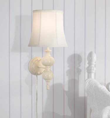 A Plug In Wall Sconce In A Bedroom Setting.