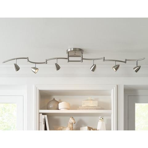 Fixture with track heads lighting a bookcase