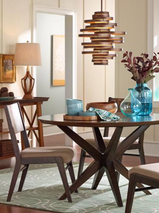 A Modern Chandelier Hangs Over A Dining Room Table.