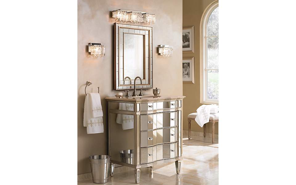 A mirror vanity with bathroom lighting.