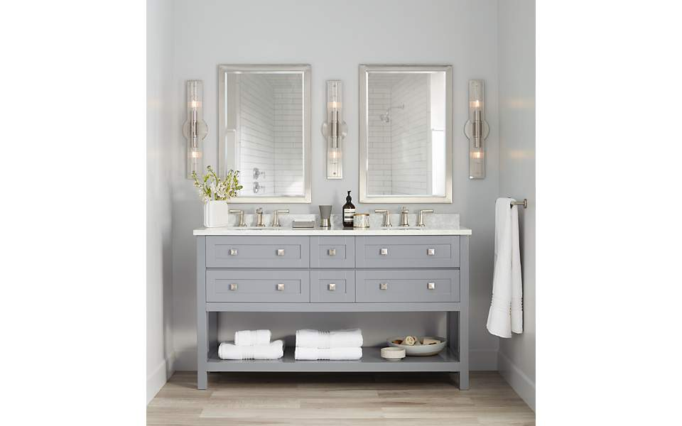 A two-sink vanity with mirrors above the sink.