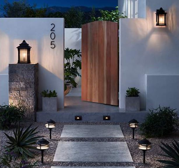 Outdoor entryway scene featuring lighting